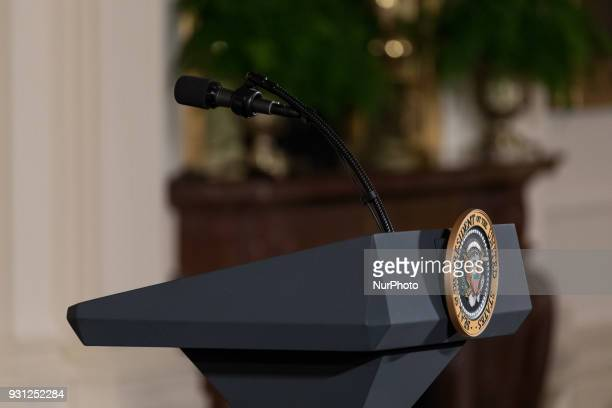 The poodium with the US Presidential Seal before the start of the celebration of the Houston Astros World Series Championship in the East Room of the...