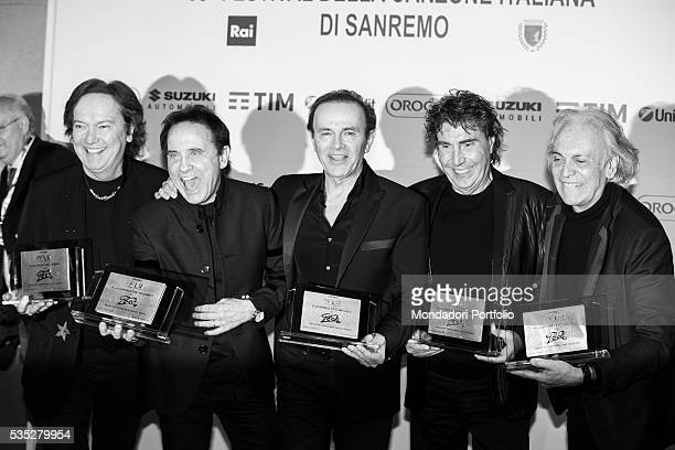 The Pooh posing smiling at the 66th Sanremo Music Festival. Sanremo, Italy. February 2016