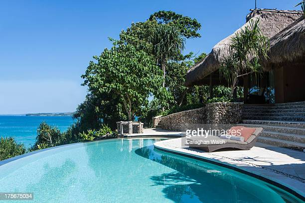 The pool and sun lounge area at the Kasambi Family Villa at Nihiwatu Resort Western Sumba on April 14 2013 Sumba is a remote island in Eastern...