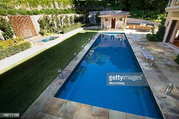 The pool area of a 15000 squarefoot custom built home lies in shadows on Belvedere Island in Marin County California US on Wednesday Dec 19 2012 The...