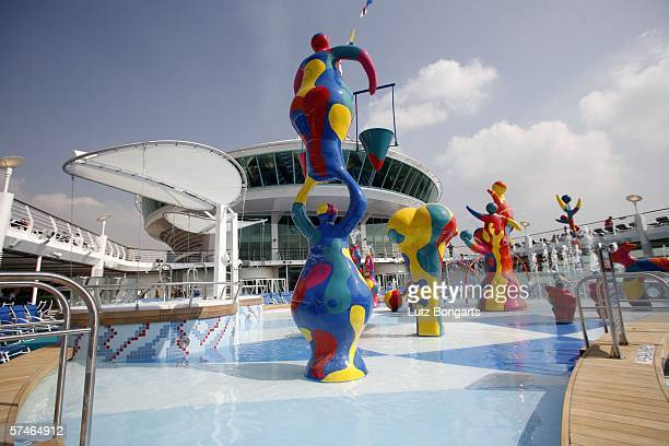 The pool area on board the 'Freedom of the Seas' the world's largest cruise ship docked on April 24 2006 in Hamburg Germany The flagship of the...
