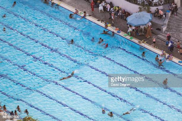 The pool of of the AlAhly club full of people swimming on September 24 2017 in Cairo Egypt Overview photos of Cairo's buildings cityscape and...
