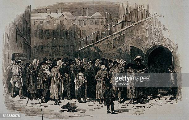 The poor and destitute of a British town receive coal during the Christmas period. Sketch drawn for the Illustrated London News, 1849.