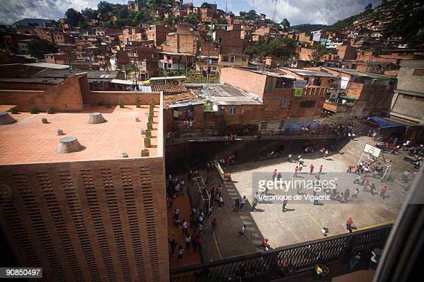 The poor neighborhoods of Medellin at the foot of the mountains are linked to the centre by cable car