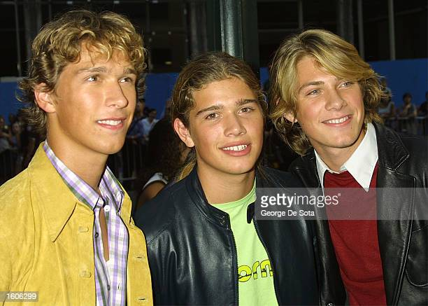 The pop group Hanson poses for photographers at the MTV 20 Live and Almost Legal party August 1 2001 at the Hammerstein Ballroom in New York City to...