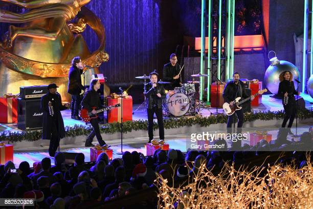 The pop group Train performs on stage during the 85th Rockefeller Center Christmas Tree Lighting Ceremony at Rockefeller Center on November 29 2017...