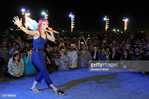 The pop punk band Paramore with Hayley Williams as the lead vocalist Josh Farro lead guitarist Jeremy Davis bass Zac Farro drummer and Taylor York as...