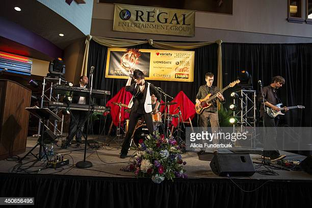"""The Pop Rox perform at the """"Hunger Games: Catching Fire"""" Knoxville Screening at Regal Pinnacle Stadium 18 on November 19, 2013 in Knoxville,..."""