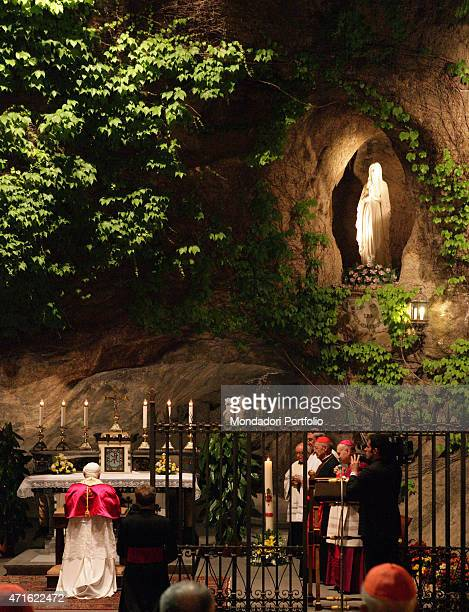 The pope Benedict XVI during the prayer in the rock cave in Lourdes for closing the month of Mary Vatican City 2005