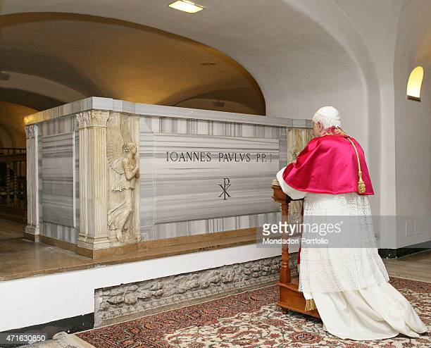 The pope Benedict XVI portrayed while praying on Pope John Paul I's grave buried inside the Vatican Grottoes Vatican City 2005