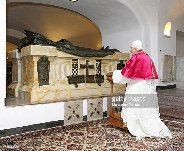 The pope Benedict XVI portrayed while praying on the graves of the popes buried inside the Vatican Grottoes Vatican City 2005