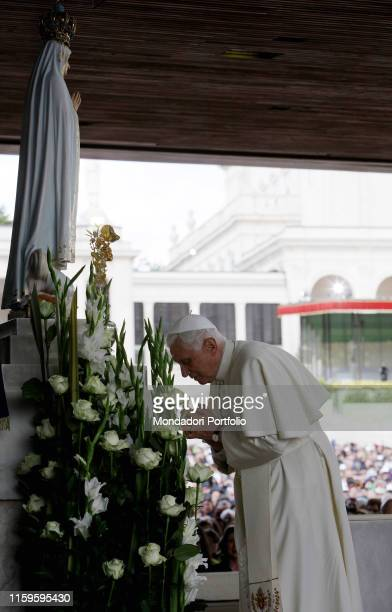 The pope Benedict XVI praying in front of the Madonna of Fatima at the Chapel of the Apparitions Fatima Portugal 12th May 2010