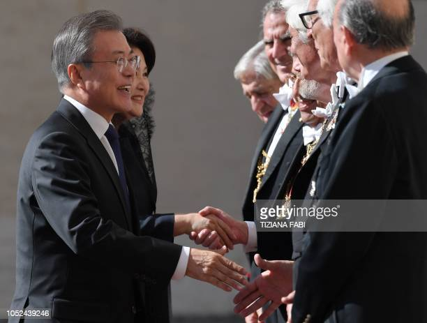 The Pope's Gentlemen greet South Korean President Moon Jae-in and his wife Kim Jung-sook upon their arrival at the Vatican for a private audience...