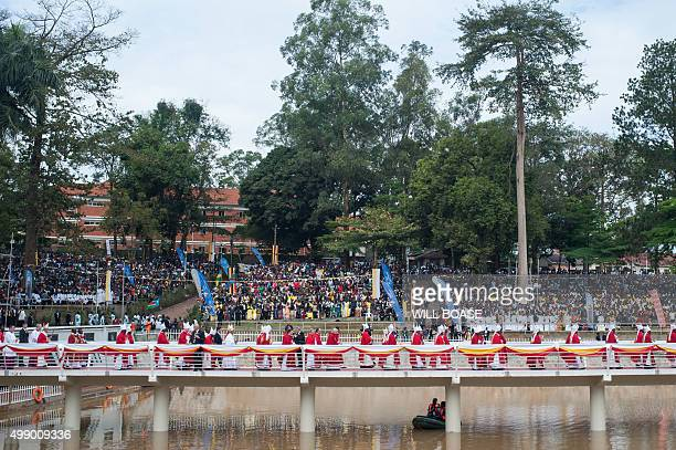 The Pope's procession crosses a footbridge towards the altar at Namugongo Martyrs' Shrine in Namugongo a suburb of Kampala to celebrate an open air...