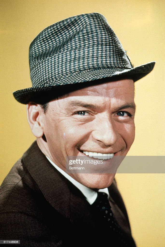 The popular American singer Frank Sinatra is shown here in this closeup photo smiling. His nicknames include 'Ol' Blue Eyes' and 'Chairman of the Board'.