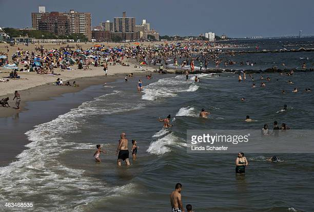The popular beach of Coney Island teeming with activity shortly before Hurricane Sandy Sandy swept through the beach resort