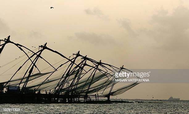 The popular Chinese fishing nets are seen at Fort Kochi in Kochi 30 September 2007 as the sun sets The Chinese fishing nets at Fort Kochi are fixed...
