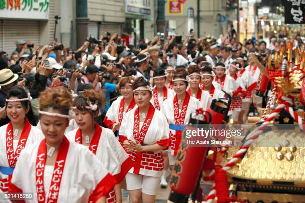The popular 'Gal Mikoshi' is paraded at Tenjinbashisuji shopping street on July 23 2017 in Osaka Japan The troop of 80 women from 15 to 30 years old...