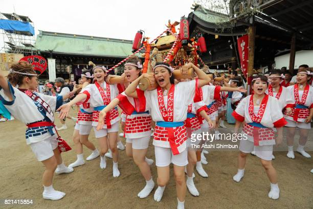 The popular 'Gal Mikoshi' is paraded on July 23 2017 in Osaka Japan The troop of 80 women from 15 to 30 years old were selected in an audition to...