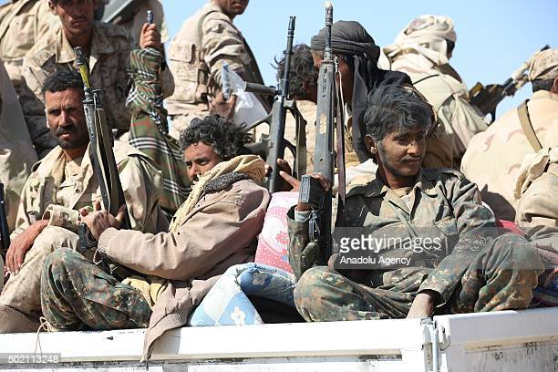 The Popular Resistance supporting Yemeni President Abd Rabbuh Mansur Hadi forces members stand guard at Hazm city of Al JAwf Yemen on December 19...