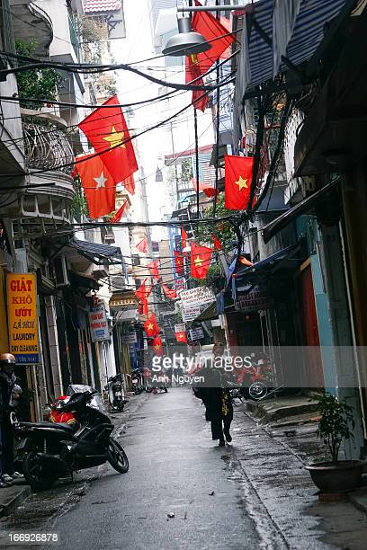 The popular street among tourists in the historical center of Hanoi, Vietnam with national flags hanging all around - on the 1st day of the New Year...