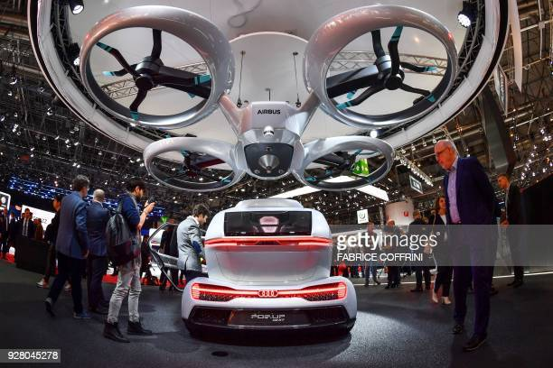 TOPSHOT The Popup next concept flying car a hybrid vehicle that blends a selfdriving car and passenger drone by Audi italdesign and Airbus is seen...
