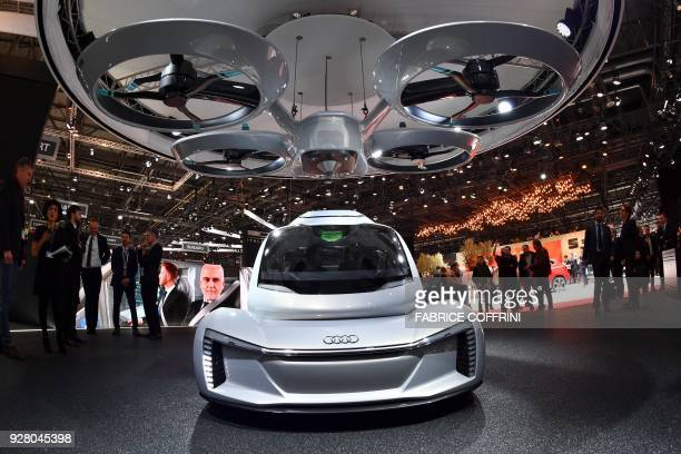 The Popup next concept flying car a hybrid vehicle that blends a selfdriving car and passenger drone by Audi italdesign and Airbus is seen during the...