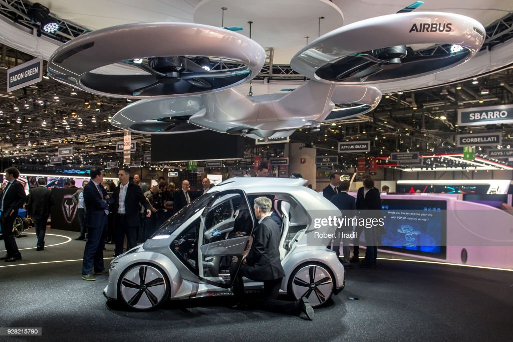 The 'Pop.up next' concept flying car, a hybrid vehicle that blends a self-driving car and passenger drone by Audi, italdesign and Airbus is seen at the 88th Geneva International Motor Show on March 6, 2018 in Geneva, Switzerland. Global automakers are converging on the show as many seek to roll out viable, mass-production alternatives to the traditional combustion engine, especially in the form of electric cars. The Geneva auto show is also the premiere venue for luxury sports cars and imaginative prototypes.
