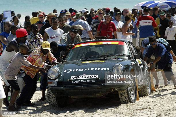 The Porche 911 of the British team Stuart Rolt and Richard Tuthill is pushed 19 December 2003 on the Kenyan South Coast 30km south of Mombasa Kenya...