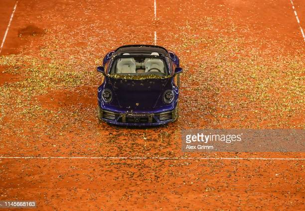The Porsche 911 Carrena 4S, the price for the winner, stands covered in glitter after the final match on day 7 of the Porsche Tennis Grand Prix at...