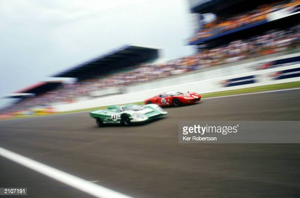 The Porsche 917 and Ford GT40 take part in the 'Legends' race during the Le Mans 24 Hours race held on June 15 2003 at The Circuit de la Sarthe in Le...