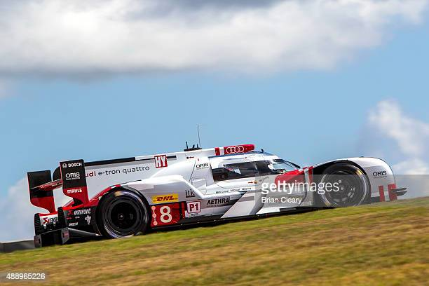 The Porsche 919 Hybrid of Romain Dumas, Neel Jani, and Marc Lieb races up a hill during practice for the FIA World Endurance Championship race at...