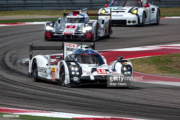 The Porsche 919 Hybrid of Romain Dumas, Neel Jani, and Marc Lieb races through a turn during practice for the FIA World Endurance Championship race...