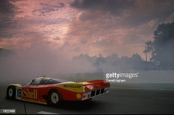 The Porsche 962 driven by Schappen Bob Wolleck Vern and Van der Merwe rounds the Arnage Bend during the Le Mans 24 Hour Race at the Circuit de la...