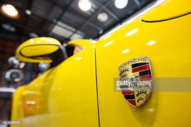 The Porsche AG badge is displayed on the side of a customized 911 Carrera vehicle at the ASeung Automotive Group garage in Seoul South Korea on...