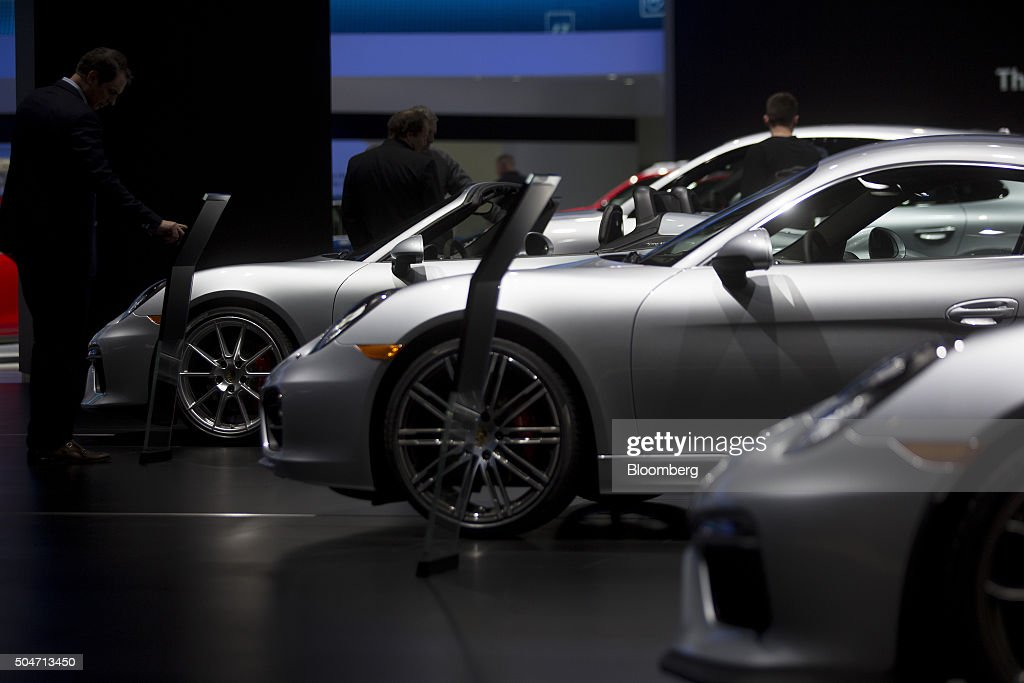 The Porsche AG Cayman S vehicle, center, sits on display during the 2016 North American International Auto Show (NAIAS) in Detroit, Michigan, U.S., on Tuesday, Jan. 12, 2016. Last year's auto show featured 55 vehicle introductions, a majority of which were worldwide debuts, and was attended by over 5,000 journalists from 60 countries. Photographer: Andrew Harrer/Bloomberg via Getty Images