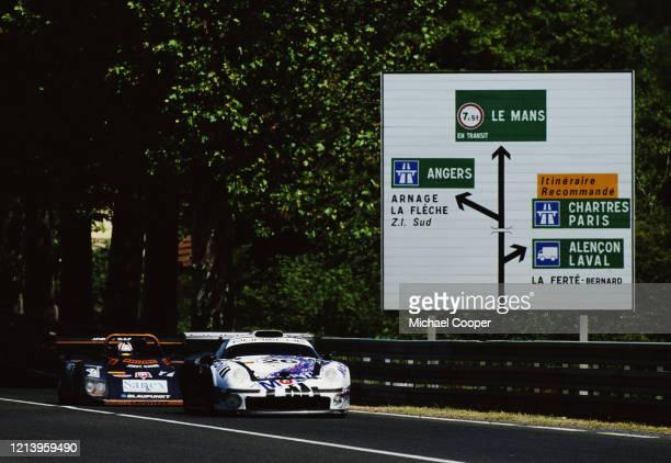 The Porsche AG Porsche 911 GT1 driven by Yannick Dalmas, Scott Goodyear and Karl Wendlinger is followed along Tertre Rouge by the Joest Racing TWR...