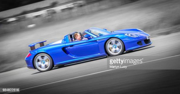 The Porsche Carrera GT takes to the track at Dunsfold Aerodrome in Surrey England Taking part in 'The Supercar Event' People were able to bid for...