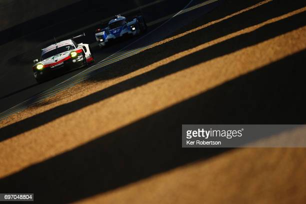 The Porsche GT Team 911 of Michael Christensen Kevin Estre and Dirk Werner drives during the Le Mans 24 Hours race at the Circuit de la Sarthe on...