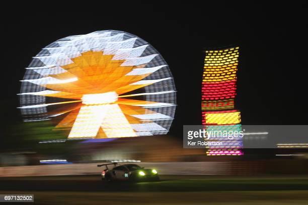 The Porsche GT Team 911 of Richard Lietz Patrick Pilet and Fred Makowiecki drives during the Le Mans 24 Hours race at the Circuit de la Sarthe on...