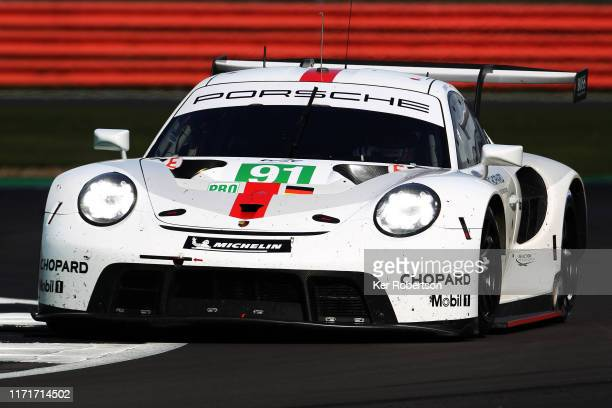 The Porsche GT Team 911 RSR of Richard Lietz and Gianmaria Bruni drives during the FIA World Endurance Championship race at Silverstone Circuit on...