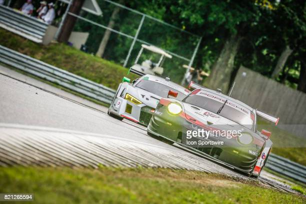 The Porsche GT Team Porsche 911 RSR driven by Patrick Pilet and Dirk Werner races ahead of competitor during the IMSA WeatherTech SportsCar...