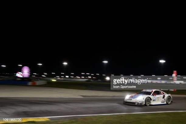 The Porsche GT Team Porsche 911 RSR of Patrick Pilet Nick Tandy and Frederic Makowiecki during the Rolex 24 at Daytona on January 27 2019 at Daytona...