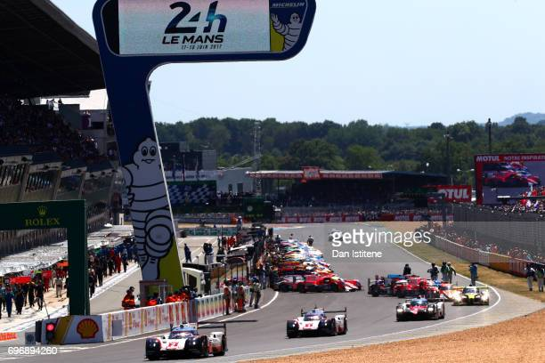 The Porsche LMP Team 919 of Earl Bamber Timo Bernhard and Brendon Hartley drives out for the parade lap before the rolling start for the Le Mans 24...