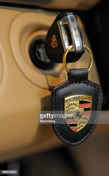 The Porsche logo is seen on a keychain inside a Porsche 911 cabriolet in Rosenheim Germany on Friday June 19 2009 Porsche SE may find its alliance...