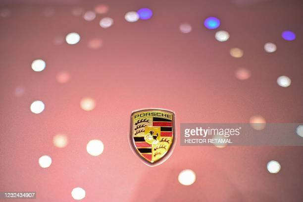 The Porsche logo is seen on a Porsche 718 Spyder car during the 19th Shanghai International Automobile Industry Exhibition in Shanghai on April 21,...