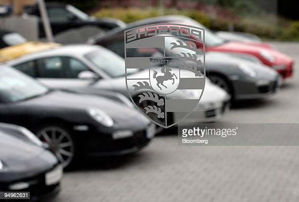 The Porsche logo is seen on the door of a Porsche dealership in Rosenheim Germany on Friday June 19 2009 Porsche SE may find its alliance with Qatar...