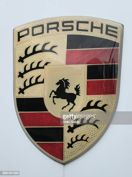 The Porsche logo stands at a Porsche dealership on June 13 2017 in Berlin Germany Spiegel magazine after conducting independent tests on a Porsche...