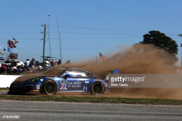 The Porsche of Ian James Mario Farnbacher and Alex Riberas kick up dirt as it goes off track during practice for the 12 Hours of Sebring at Sebring...