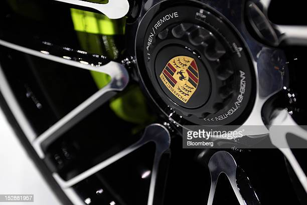 The Porsche SE logo sits on the wheel hub of Porsche Panemera Sport Turismo automobile produced by Porsche SE on the first day of the Paris Motor...
